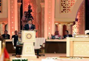 Ahmet Davutoglu attended the Arab League`s 24th Ordinary Summit in Qatar where Syria and Palestine dominated the agenda