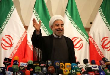 `US should end intervening in Iran`s internal affairs first and recognize Iranians` right to nuclear energy to negotiate with Iran,` Rowhani says
