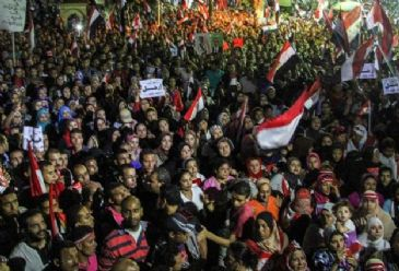 Resignations follow Sunday's mass protests against President Mohammad Morsi