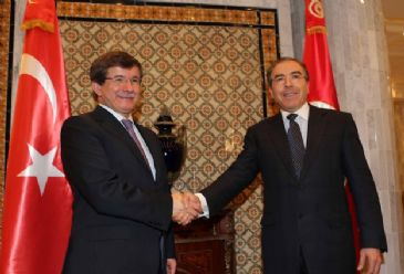 Turkish Foreign Minister Ahmet Davutoglu and leader of Tunisia's largest party Ennahda Rachid al-Ghannouchi have described Tunisia as a