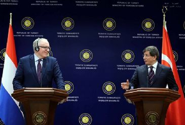 Davutoglu notes a `positive momentum` in terms of resolving the Cyprus conflict and calls for a just attitude from the EU.