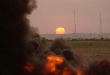 Oil deliveries from the northern Iraqi city of Kirkuk to Turkey through the Ceyhan marine transport terminal on Turkey`s southeastern coast were suspended on Monday following an explosion that targeted an oil pipeline, an Iraqi official said.
