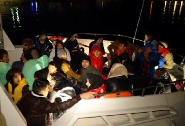 Turkish coast guard rescues 28 migrants after vessel begins to sink.