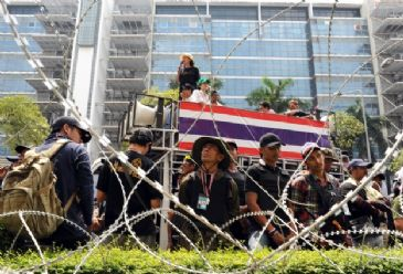 Thai political battle gets personal with protest leaders launching verbal attacks on PM`s family and Shinawatra Inc.