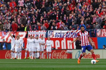 Runners-up Atletico Madrid miss the leadership chance by drawing with the Spanish La Liga leaders Real Madrid 2-2 at their home ground Vicente Calderon Stadium