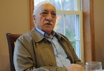 Azeri media claims a group, led by preacher Fethullah Gulen, infiltrates state and finds cohorts among politicians.