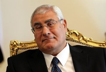 Egypt`s interim president Adly Mansour on Saturday signed into law a new bill that regulates Egypt`s presidential elections.