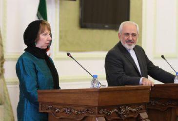 EU`s Ashton meets Iranian Foreign Minister Zarif on her first visit to Tehran, calls negotiations `challenging` with no guarantee of success