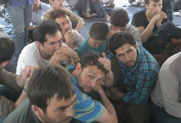 Source tells the Anadolu Agency that he suspects unidentified group are Uighur Muslims from Xinjiang province in China.