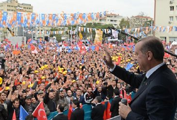 Erdogan address rallies in two cities lost to electoral rivals in 2009.