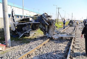Five people wounded and nine dead after a passenger train collides with a minibus in Mersin city, southern Turkey.