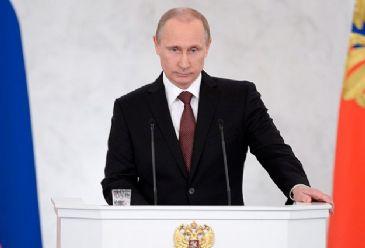 Russian President Vladimir Putin Friday mocks U.S. sanctions imposed on Russia.