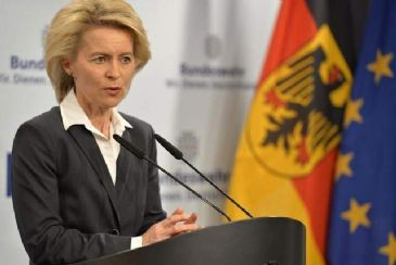 Germany's Defense Minister calls for stronger NATO presence at Ukraine's borders, but faces opposition from the Christian Democrats Union's coalition partner.
