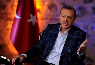 Turkey's PM Erdogan says those attacking the only Turkish territory out of its borders would face retaliation from Turkey