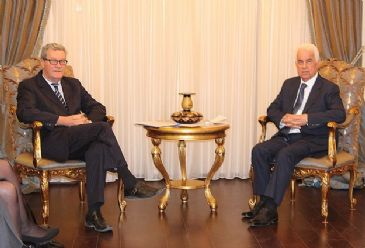 Turkish Cypriot President Dervis Eroglu welcomes former United Nations envoy on Wednesday.