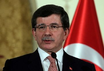 Turkey's Foreign Minister Ahmet Davutoglu has said the country's armed forces are ready for every possibility regarding Turkish territory in Syria which is home to the symbolically-important Suleyman Shah Tomb