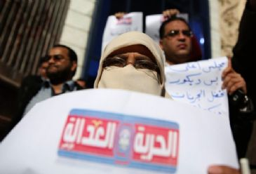A female Egyptian journalist was killed during a Friday protest staged by supporters of ousted president Mohamed Morsi in eastern Cairo, the slain journalist's employer said.