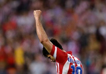 Atletico Madrid took another step towards their first La Liga title for 18 years as two goals in the last 20 minutes handed them a 2-0 win over Elche at the Vicente Calderon on Friday.