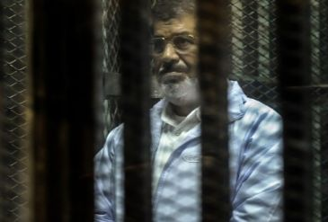 Morsi and his 14 co-defendants are charged with inciting the murder of opposition demonstrators outside the palace
