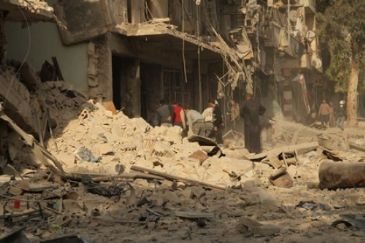 Forces loyal to Assad also accused of launching attacks using barrel bombs filled chlorine gas