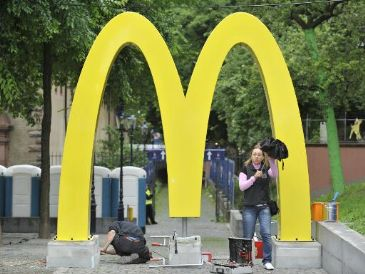Fast-food chain McDonald's said Tuesday its first-quarter profit dropped 5.2 percent amid declining sales in its key US home market, and vowed to boost global sales.