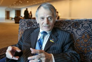 Crimean Tatar leader Kirimoglu says he will return to the peninsula amid rumors he is banned