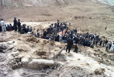 As search and rescue efforts wind down in the Abe Barik village, which was consumed by a landslide, it is announced it will become a mass grave