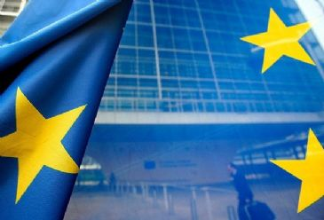 European Union promises extra financial aid to Greece on condition of Greece's commitment to international programs