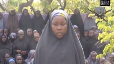 The militant Boko Haram group has released a new video showing scores of abducted schoolgirls, saying they would be released in return for imprisoned militants.