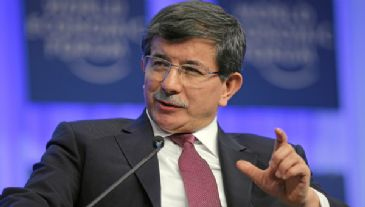 Turkey's Foreign Minister Ahmet Davutoglu said Tuesday the country's does not need to pay any compensation to Greek Cypriots for Ankara's 1974 peace mission in Cyprus