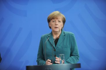German Chancellor dismisses self-rule referendum in eastern Ukraine while International Monetary Fund head fears fund's bailout will not be enough.