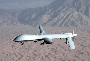 The death toll from a U.S. drone strike on a militant hideout near the Pakistan-Afghanistan border Wednesday morning has risen to 10, a security official said