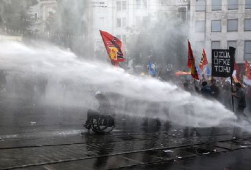 Riot police intervene as demonstrators march in Ankara and Istanbul in support of victims of mine fire disaster