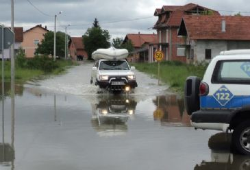 Death toll from Bosnia-Serbia floods rises to 19 after rescue teams reach 14 more bodies