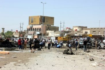 At least 10 people were killed and 11 others injured Monday in separate attacks in the Iraqi capital Baghdad, a security source said.