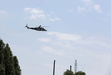 Ukraine has sent in helicopters as they attempt to bring an end to separatists' seizure of the airport in Donetsk.