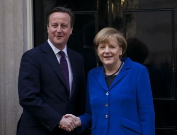 UK premier David Cameron meets German counterpart Merkel in Sweden to repeat his opposition to Juncker's possible presidency of EU Commission