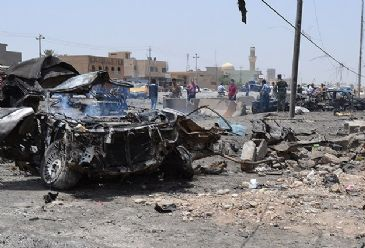 At least 20 people were killed and 110 injured in two suicide bombings that targeted a checkpoint in Tuz Khormato in Iraq's northern Saladin province, medical and security sources have said.