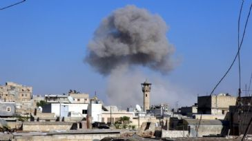 Areas controlled by Syrian opposition in Aleppo come under attack from army helicopters