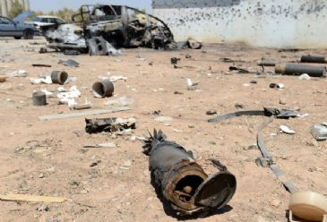 Three checkpoints, one armed personnel carrier, one Humvee, two armed trucks, and an additional Islamic State truck were destroyed