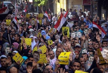 Supporters of ousted president Mohamed Morsi staged a flash protest late Tuesday near eastern Cairo's Rabaa al-Adawya Square, two days before the first anniversary of the violent dispersal of their protest camp last summer