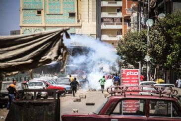 At least six Egyptians were killed on Thursday when security forces dispersed rallies marking the passage of one year since the bloody dispersal of two major sit-ins by supporters of ousted president Mohamed Morsi in Cairo and Giza