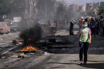 The death toll from the dispersal of protests staged by supporters of ousted president Mohamed Morsi rose to six on Friday as violence continued to mar the first anniversary of the bloody dispersal of two pro-Morsi protest camps in Cairo and Giza