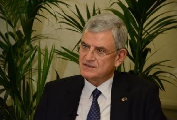 In phone conversation with EU's enlargement chief, Volkan Bozkir, says executive branch was not involved in Sunday's police operation