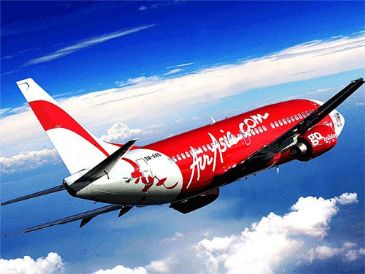 An AirAsia plane with 161 people on board lost contact with air traffic control en route from Indonesia to Singapore Sunday morning, an official said.